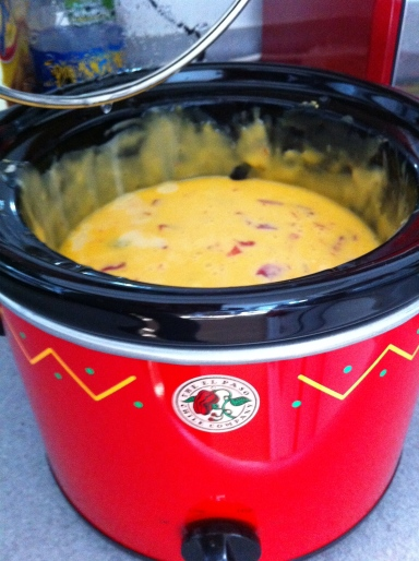 Cheese dip in red crock pot