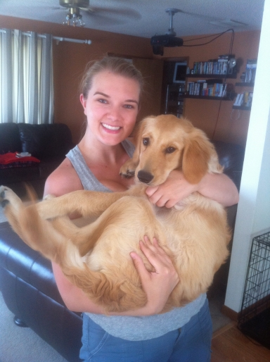 me holding calie (golden retriever puppy)