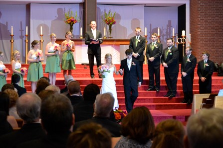 the whole bridal party at the alter