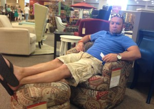 Chris sitting in chair at Homemakers